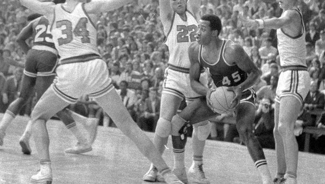 Washington High's  George McGinnis (45) found himself surrounded by a trio of Silver Creek players during a 1969 game at Hinkle Fieldhouse.