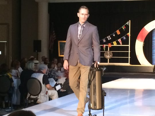 Palm Springs Police Officer Chad Nordman walks the runway Friday.