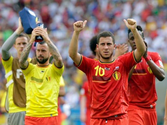 Belgium's Eden Hazard (10) and his teammates applaud spectators following Belgium's 1-0 victory over Russia during the group H World Cup soccer match between Belgium and Russia at the Maracana Stadium in Rio de Janeiro, Brazil, Sunday, June 22, 2014. (AP Photo/Bernat Armangue)