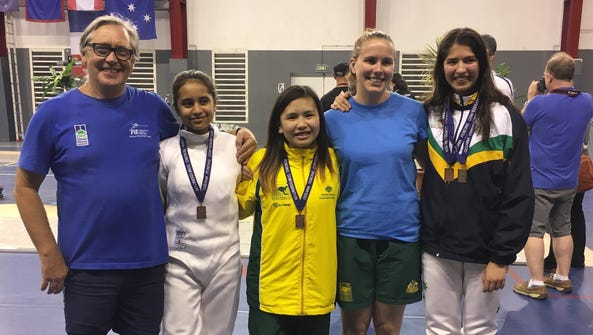 Anica Camacho, second from left, is shown with her
