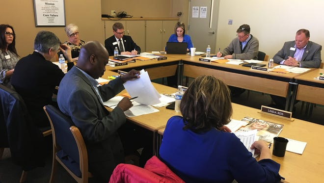 Terra State Community College's board of trustees listen to an update on the college's student housing project and finances at its meeting on April 25. The college has recently cut hours and eliminated positions to reduce Terra State's budget deficit.