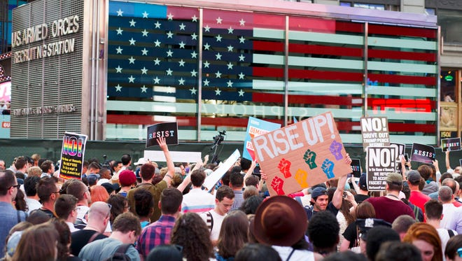 People protest President Trump's announcement that Transgender people will not be allowed to serve in the US military  in Times Square in New York on July 26, 2017.
