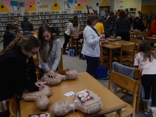 Students at Fort Gratiot Middle School learn how to do CPR on adults and infants.