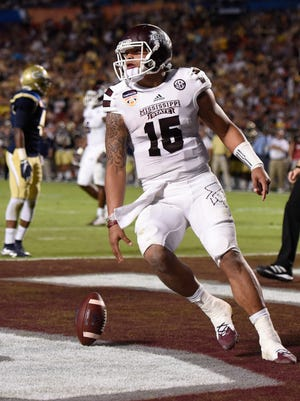 Dec 31, 2014; Miami Gardens, FL, USA;  Mississippi State Bulldogs quarterback Dak Prescott (15) in the  second quarter Orange Bowl at Sun Life Stadium. Mandatory Credit: Brad Barr-USA TODAY Sports