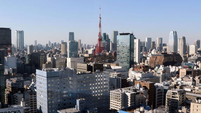 A general view of the Tokyo Tower (C) and the skyline of central Tokyo.