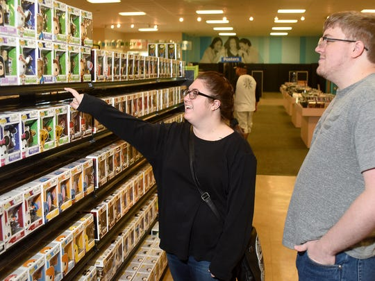 Jessica Farrell, left, and Logan Hanhartd visit EntertainMART on Wednesday at 3020 E. 20th St. in Farmington.