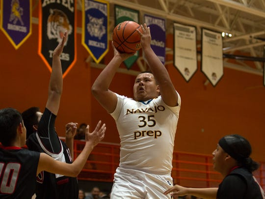 Navajo Prep's Dylan Begay puts up a shot against Crownpoint on Friday at Lillywhite Gym in Aztec.