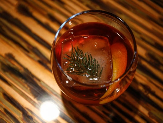 Alpine Negroni with a sprig of pine frozen into the