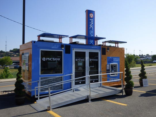 SHRINKING BRANCHES: PNC's tiny branch is constructed