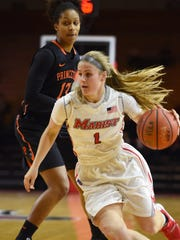 Marist College's Claire Oberdorf drives past Princeton's Vanessa Smith during a Dec. 29 game at McCann Arena.
