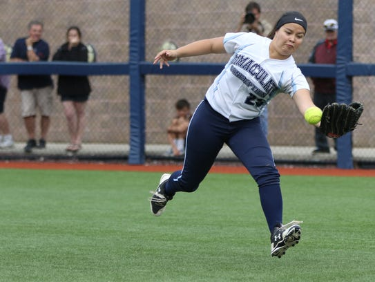 Kayla Robert of Immaculate Conception tries to catch