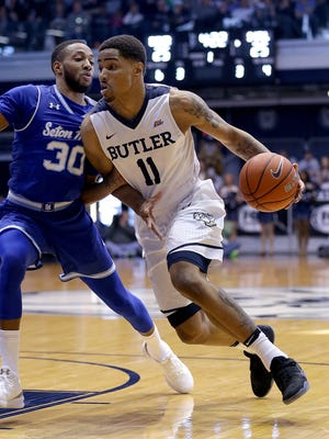 "Basketball is Butler's bread and butter, but other teams are succeeding at doing more with less as well. ""We play small ball, find avenues to get points,"" track coach Matt Roe says. In March, Bulldogs guard Kethan Savage drove on Seton Hall Pirates guard Madison Jones during a Big East game at Hinkle Fieldhouse."