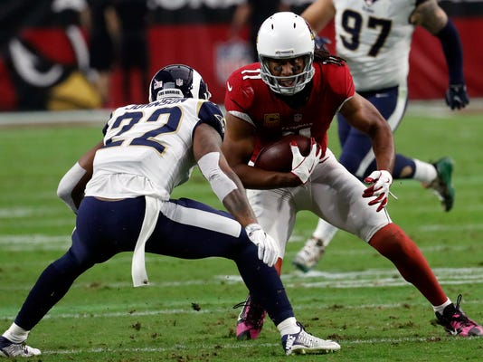 FILE - In this Dec. 3, 2017, file photo, Arizona Cardinals wide receiver Larry Fitzgerald (11) during the first half of an NFL football game against the Los Angeles Rams in Glendale, Ariz. Fitzgerald needs 26 yards receiving to pass Randy Moss into third on the NFL career list (trailing only Terrell Owens and Jerry Rice). (AP Photo/Rick Scuteri, File)
