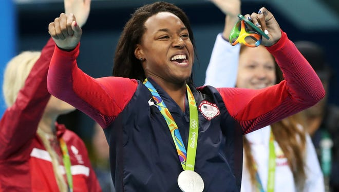 Unites States' Simone Manuel celebrates her silver medal for the women's 50-meter freestyle final during the swimming competitions at the 2016 Summer Olympics,
