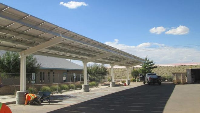 The sun-harvesting solar panels atop a new shade structure at the Sage Café Community Center, 6121 Reynolds Drive, produce as much renewable energy as the 5,387-square-foot building consumes.