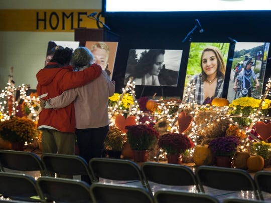 Mourners gather at a memorial to the five teenagers who died in a head-on crash on I-89 during a celebration of their lives at Harwood Union High School in Duxbury on Monday, Oct. 24.