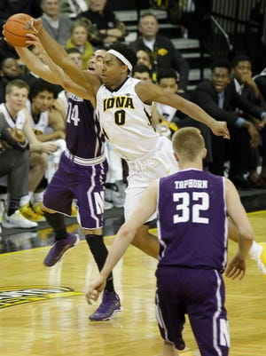 Iowa forward Ahmad Wagner makes a play for the ball during a game against Northwestern at Carver-Hawkeye Arena on Sunday.