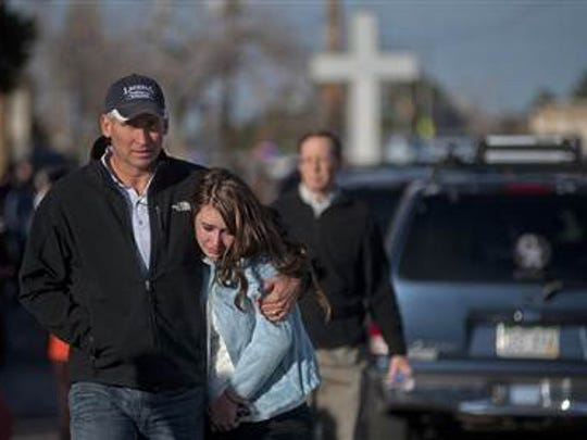 Sydney Barton and her dad Randal walk to their car after a school shooting at Arapahoe High School, where Sydney was a student, in suburban Denver in December 2013.