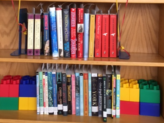 A Little Free Library: Take a Book-Return a Book, sponsored