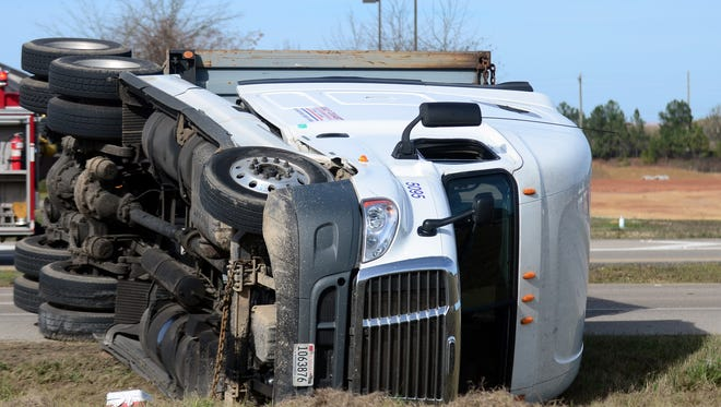 U.S. 98 at Gravel Pit Road was blocked due to an overturned 18-wheeler.