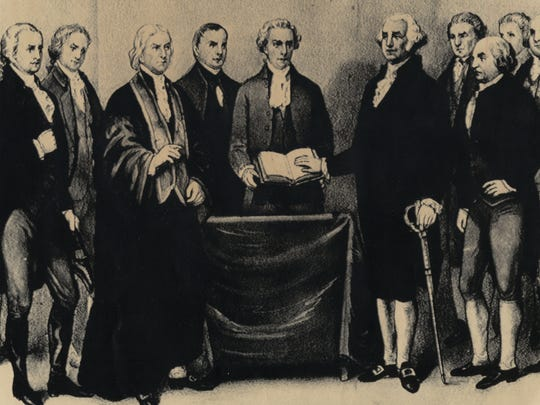 FIRST INAUGURATION: George Washington's Innauguration. Reproduction of the scene at old Federal Hall in New York on April 30, 1739 as George Washington took the oath of office to become the first president of the United States.