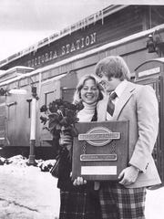 Tracy Lytle and Rob Lytle receiving the Wiseman Trophy from Victoria Station, 1976,