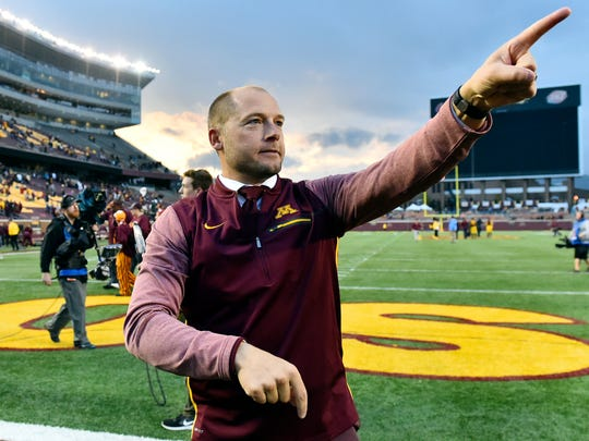 FILE - In this Oct. 21, 2017, file photo, Minnesota head coach P.J. Fleck acknowledges the the fans in the students section after a 24-17 victory over Illinois in a NCAA college football game in Minneapolis. The University of Minnesota and Fleck have agreed to a one-year contract extension through the 2022 season.  (AP Photo/John Autey, File)