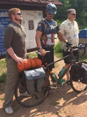 Ryan, Kyle and their father Todd Shilts pose for a photo as Kyle prepares to leave for Oshkosh from the Mountain-Bay Trail head in Weston.