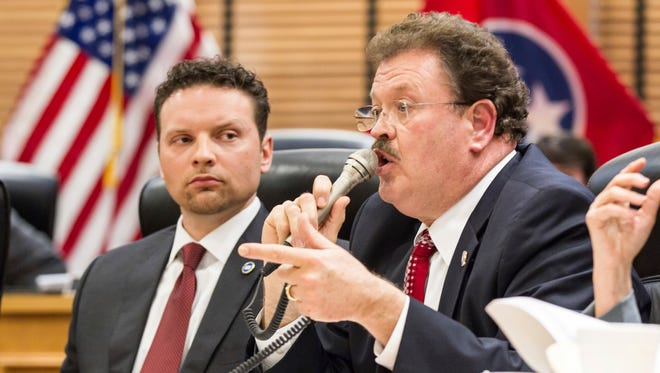 Rep. Jerry Sexton, R-Bean Station, argues for a delay in considering Gov. Bill Haslam's transportation funding proposal during a House Transportation Committee meeting in Nashville, Tenn., on Tuesday, March 7, 2017, while Rep. Jason Zachary, R-Knoxville, looks on. The bill was ultimately delayed until next week. (AP Photo/Erik Schelzig)