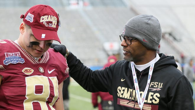 Florida State Seminoles incoming head coach Willie Taggart talks to tight end Ryan Izzo (81) after the win over the Southern Mississippi Golden Eagles in the 2017 Independence Bowl at Independence Stadium. Florida Sate won 42-13.