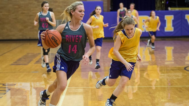 Rivet's Grace Waggoner (14) drives the ball down the court during practice at Vincennes Rivet High School on Thursday, Feb. 22, 2018.