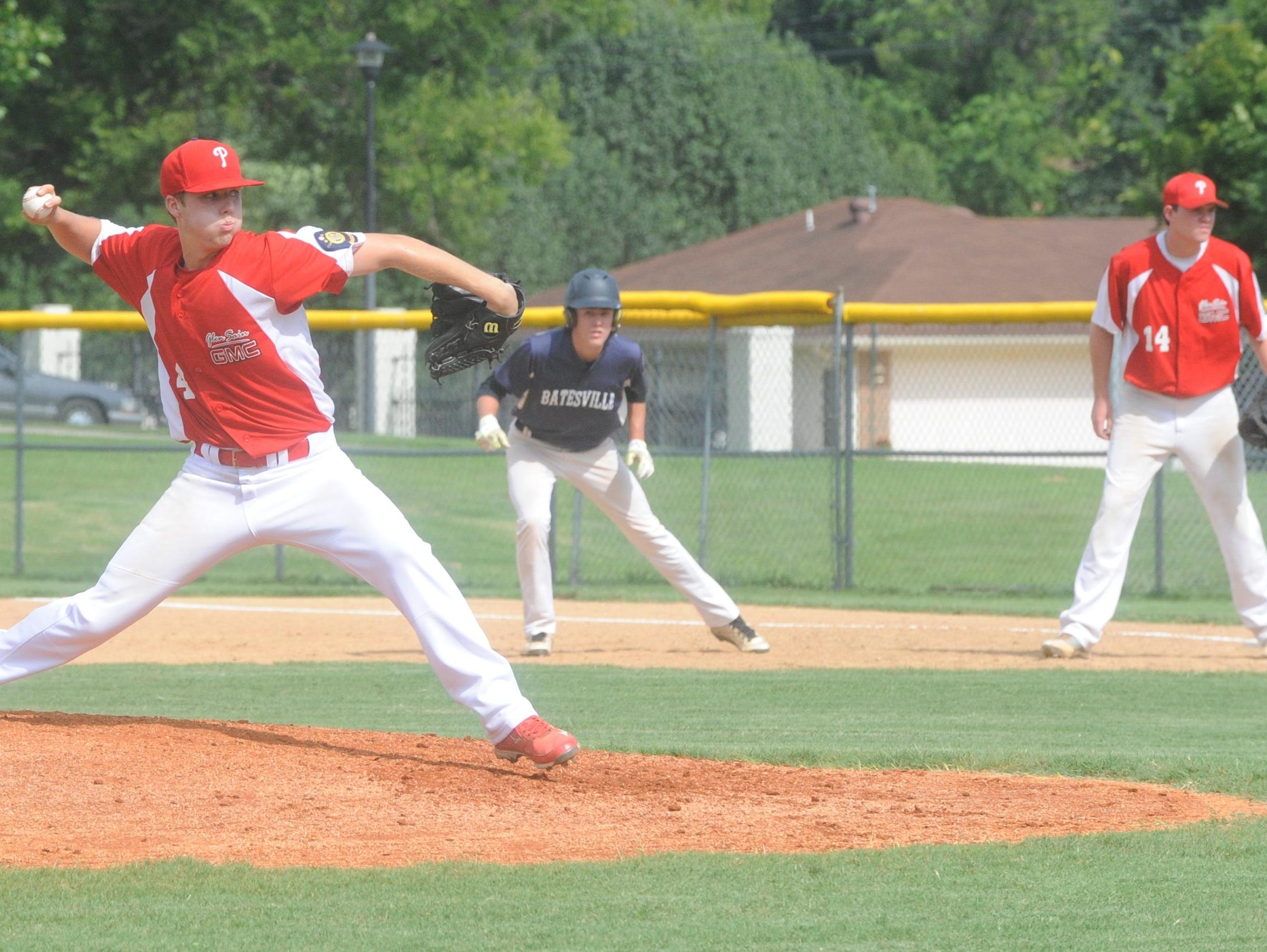 Paragould pitcher Trace Huckabay, left, delivers a pitch while Batesville's Jesse Sampley leads away from first base during Glen Sain GMC's 15-5 victory over the Highwaymen in the first round of the Zone 2 American Legion District Tournament on Friday at Cooper Park.