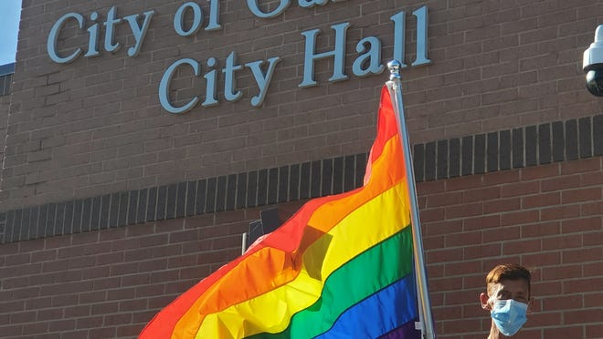 Doug Summers of Galesburg holds a rainbow flag on the steps of Galesburg City Hall Monday following the proclamation of June as Pride Month in Galesburg.