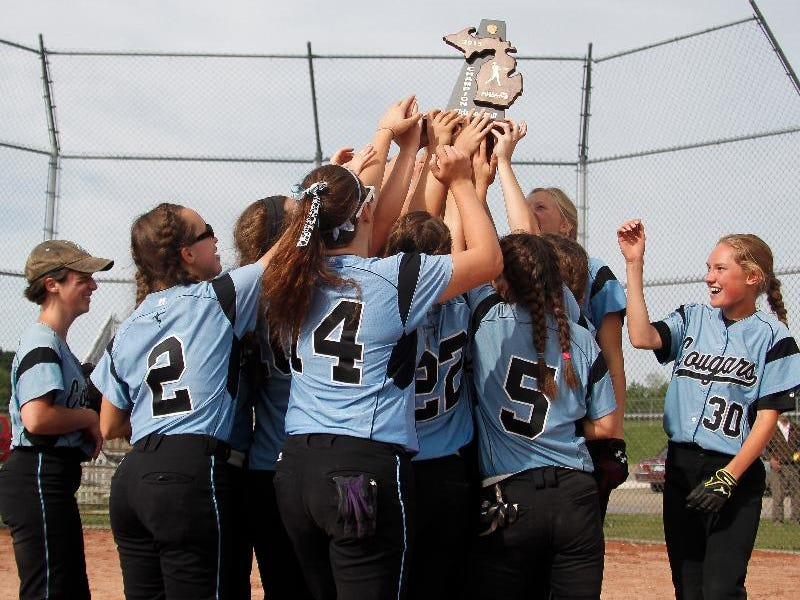 Members of the Lansing Catholic softball team celebrate their 8-1 Div. 3 District championship June 1, 2015, at Leslie.