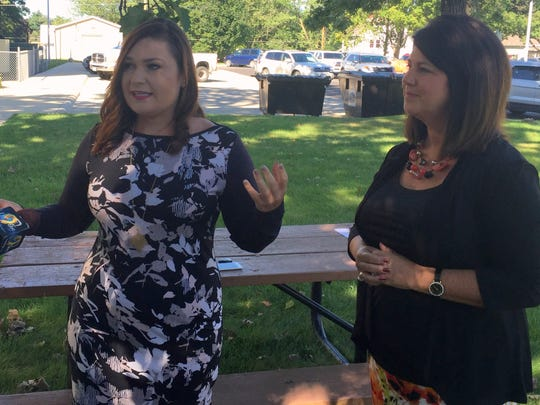 State Rep. Abby Finkenauer, D-Dubuque, left, and Tammy Wawro of Cedar Rapids, president of the Iowa State Education Association, talk with reporters in Anamosa, Iowa, on Thursday, Sept. 1, 2016. They contended Sen. Chuck Grassley's annual 99-county tour is misleading because many events are private and not open to the public. Grassley said he is simply trying to meet a cross-section of Iowans.