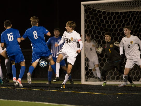 Holmdel's Mark McStay punches in a goal to  tie the