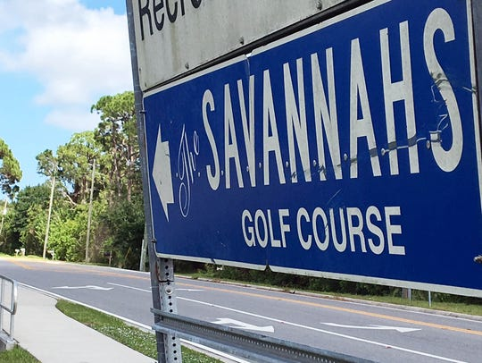 A sign points the way to The Savannahs golf course