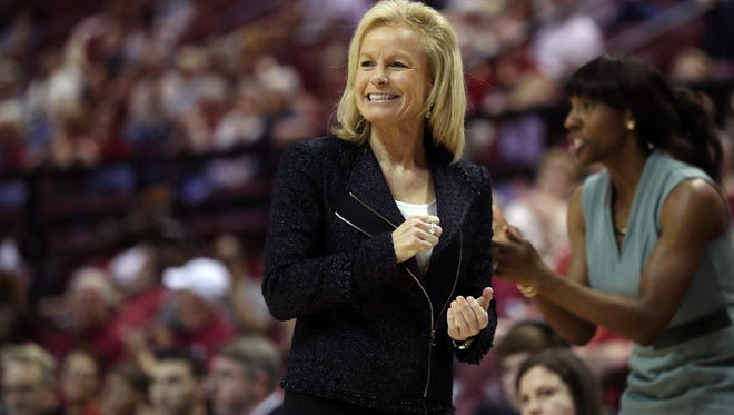 FSU Head Coach Sue Semrau smiles from the sidelines as her team takes on Georgia Tech at the Tucker Civic Center on Sunday, Feb. 25, 2018.