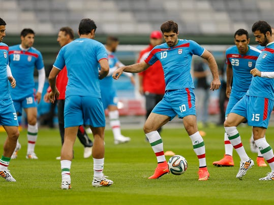 Iran's Karim Ansarifard, third from right, plays the ball during an official training session the day before the group F World Cup soccer match between Iran and Nigeria at the Arena da Baixada in Curitiba, Brazil, Sunday, June 15, 2014.  (AP Photo/Frank Augstein)