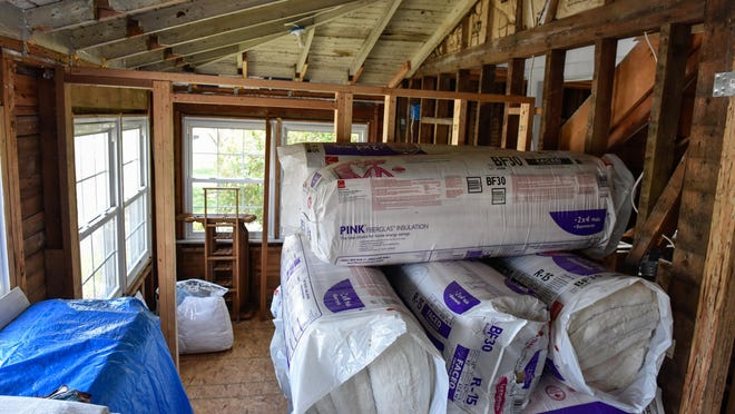 Building materials sit inside a Sandy-damaged home that is being rebuilt in Monmouth Beach.