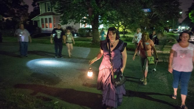 Jersey Shore Ghost tours led a haunted tour through Keyport, NJ, on Saturday, August 8, 2015. Tour guide Genevieve Kelly (holding lantern) leads the way to the next stop. /Russ DeSantis/Special to the Asbury Park Press / SLUG-ASB 0808 Keyport haunted tour