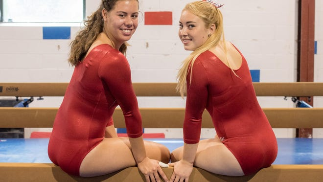 Ocean Twp. High School gymnasts Olivia Yasser (left) and Cassidy Marquette.