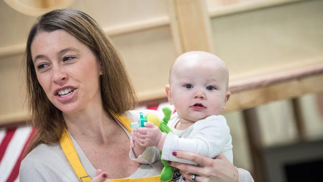 Adrienne Oliveros, owner of Coco Beans Play Cafe in Tinton Falls, is pictured with her son, Calvin Oliveros, 5 months.