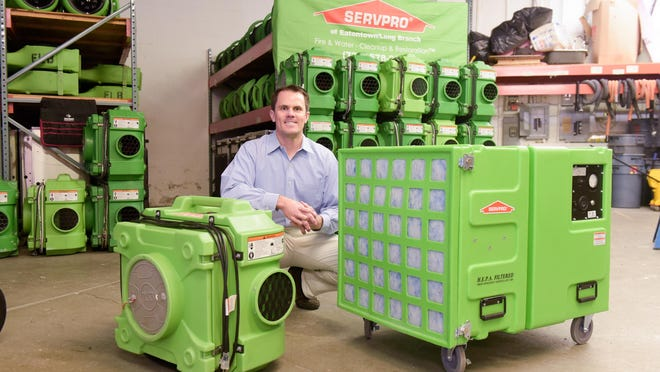 John Majeski, owner of the Servpro of Eatontown/Long Branch franchise, shows off different types of air scrubbers.