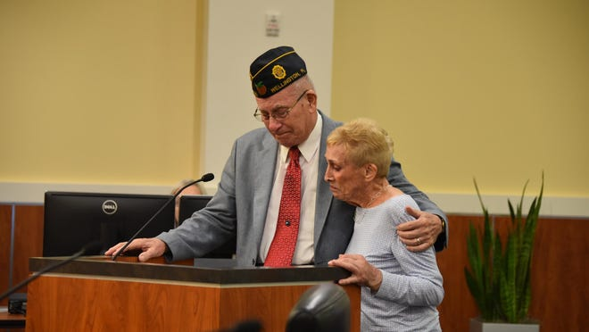 Former Wellington Mayor Tom Wenham and his wife, Regis, react Feb. 25 after the Wellington Village Council voted unanimously to add Tom Wenham's name to the village's founder's plaque.
