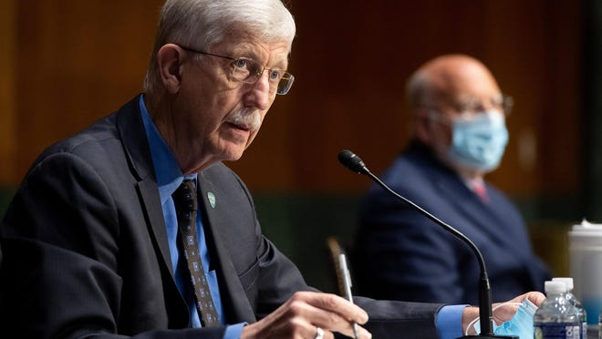 Dr. Francis Collins,, left, Director of the National Institutes of Health (NIH), and Dr. Robert Redfield, Director of the Centers for Disease Control and Prevention (CDC), testify during a US Senate Appropriations subcommittee hearing on the plan to research, manufacture and distribute a coronavirus vaccine on July 2, 2020 on Capitol Hill in Washington, DC.