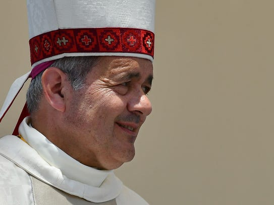 The bishop of Osorno, Juan Barros, takes part in an