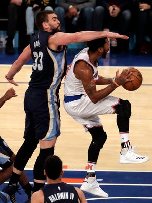 Grizzlies' center Marc Gasol (left) looks to block New York Knicks' guard Derrick Rose (right) from driving to the basket in the first half of the NBA game between the Memphis Grizzlies and the New York Knicks at the Madison Square Garden in New York on Saturday.