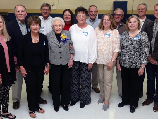 Former students of Marie Wiggins pose for a group photo with her during a surprise thank you party for the retired Metro teacher at Gra-Mar middle school Sunday April 22, 2018.