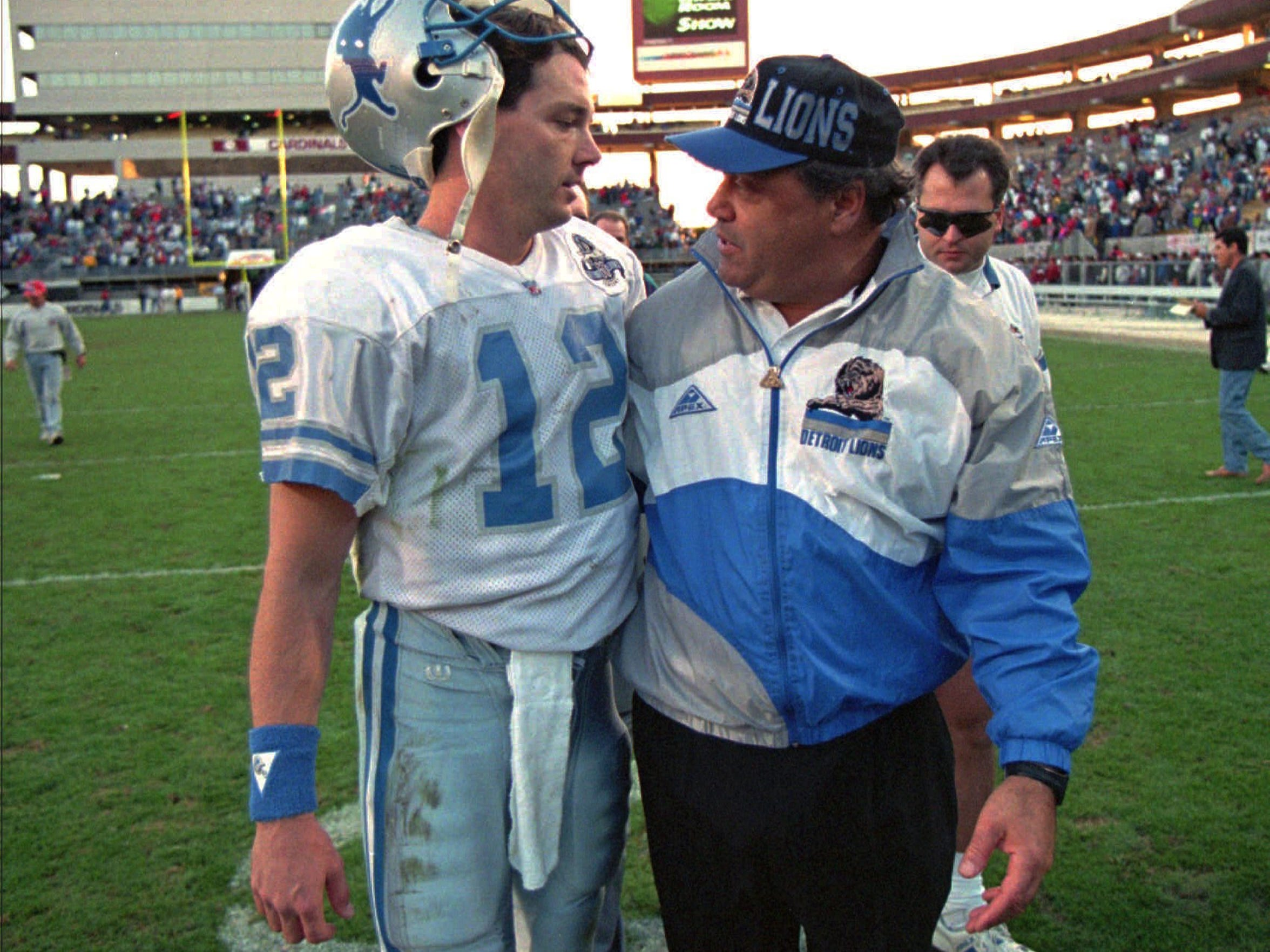 In a Detroit Free Press file photo, Lions' coach Wayne Fontes hugged his new QB Erik Kramer as they walked off the field after their 21-14 win over Phoenix.